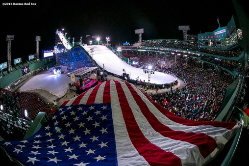 """An American flag waves from the US Free Ski suite during the Polartec Big Air at Fenway ski and snowboard competition at Fenway Park in Boston, Massachusetts Friday, February 12, 2016."""