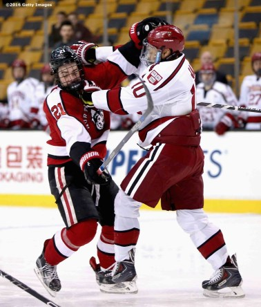 BOSTON, MA - FEBRUARY 08: Nolan Stevens #21 of Northeastern University is pushed by Brayden Jaw #10 of Harvard University during the first period of the Beanpot Tournament consolation game at TD Garden on February 8, 2016 in Boston, Massachusetts. (Photo by Billie Weiss/Getty Images) *** Local Caption *** Nolan Stevens;Brayden Jaw