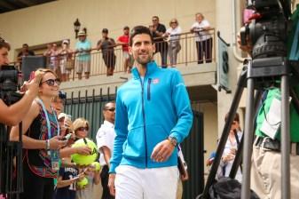 """Novak Djokovic unveils champions mural at the Indian Wells Tennis Garden in Indian Wells, California Friday, March 11, 2016."""