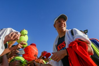 """""""Caroline Wozniacki signs autographs during the 2016 BNP Paribas Open at the Indian Wells Tennis Garden in Indian Wells, California Saturday, March 12, 2016."""""""