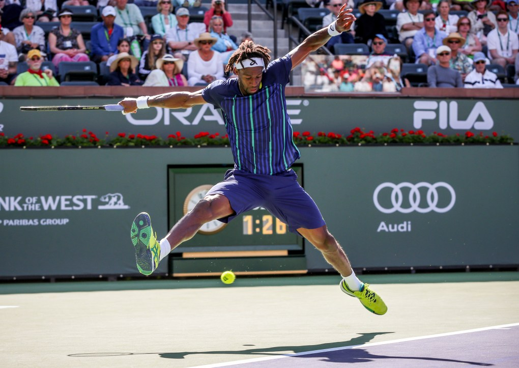 """""""Gael Monfils in action against Pablo Carreno Busta during the 2016 BNP Paribas Open at the Indian Wells Tennis Garden in Indian Wells, California Saturday, March 12, 2016."""""""