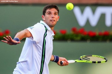"""Federico Delbonis in action against Gael Monfils during the 2016 BNP Paribas Open at the Indian Wells Tennis Garden in Indian Wells, California Wednesday, March 16, 2016."""