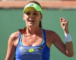 """Agnieszka Radwanska reacts after defeating Petra Kvitova during the 2016 BNP Paribas Open at the Indian Wells Tennis Garden in Indian Wells, California Wednesday, March 16, 2016."""