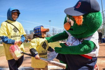 April 16, 2016, Boston, MA: RBI League players are greeted by mascot Wally the Green Monster after winning Boston Red Sox tickets in a raffle during RBI Opening Day at Jim Rice Field in Boston, Massachusetts Saturday, April 16, 2016. (Photo by Billie Weiss/Boston Red Sox)