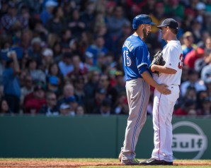 BOSTON, MA - APRIL 17: Chris Colabello #15 of the Toronto Blue Jays and Steven Wright #35 of the Boston Red Sox embrace after Wright hit Colabello in the head with a pitch during the fourth inning of a game on April 17, 2016 at Fenway Park in Boston, Massachusetts . (Photo by Billie Weiss/Boston Red Sox/Getty Images) *** Local Caption *** Chris Colabello; Steven Wright