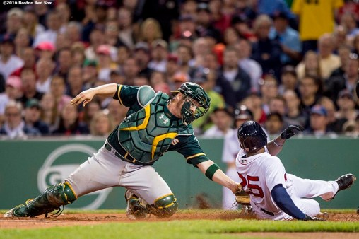 BOSTON, MA - MAY 11: Jackie Bradley Jr. #25 of the Boston Red Sox is tagged out by Stephen Vogt #21 as he attempts to score on a ground ball during the fifth inning of a game against the Oakland Athletics on May 11, 2016 at Fenway Park in Boston, Massachusetts. (Photo by Billie Weiss/Boston Red Sox/Getty Images) *** Local Caption *** Jackie Bradley Jr.; Stephen Vogt