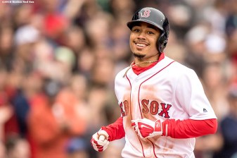 BOSTON, MA - MAY 21: Mookie Betts #50 of the Boston Red Sox reacts after hitting a solo home run during the fourth inning of a game against the Cleveland Indians on May 21, 2016 at Fenway Park in Boston, Massachusetts. (Photo by Billie Weiss/Boston Red Sox/Getty Images) *** Local Caption *** Mookie Betts