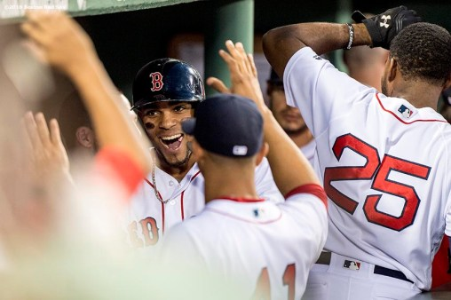 BOSTON, MA - MAY 25: Xander Bogaerts #2 of the Boston Red Sox high fives teammates after hitting a solo home run during the fourth inning of a game against the Colorado Rockies on May 25, 2016 at Fenway Park in Boston, Massachusetts. (Photo by Billie Weiss/Boston Red Sox/Getty Images) *** Local Caption *** Xander Bogaerts