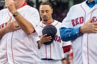 BOSTON, MA - MAY 25: Mookie Betts #50 of the Boston Red Sox stands alongside members of the 1986 Boston Red Sox during a 1986 team 20-year reunion ceremony before a game between the Boston Red Sox and the Colorado Rockies on May 25, 2016 at Fenway Park in Boston, Massachusetts. (Photo by Billie Weiss/Boston Red Sox/Getty Images) *** Local Caption *** Mookie Betts