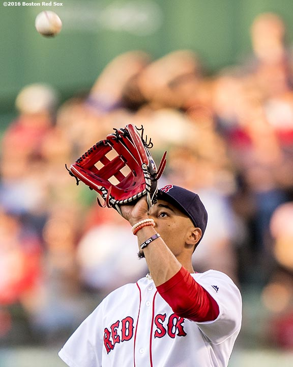 BOSTON, MA - JUNE 15: Mookie Betts #50 of the Boston Red Sox catches a fly ball during the second inning of a game against the Baltimore Orioles on June 15, 2016 at Fenway Park in Boston, Massachusetts. (Photo by Billie Weiss/Boston Red Sox/Getty Images) *** Local Caption *** Mookie Betts