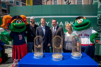 June 15, 2016, Boston, MA: (From left to right) Boston Red Sox mascot Tessie, Boston Red Sox pitcher Matt Barnes, Boston Red Sox President Sam Kennedy, Faneuil Hall General Manager Joe O'Malley, Faneuil Hall Merchant's Association President Carol Troxel and Boston Red Sox mascot Wally the Green Monster pose for a photograph with the 2004, 2007, and 2013 World Series trophies during the unveiling of the Red Sox Showcase Mobile Truck powered by T-Mobile at Faneuil Hall in Boston, Massachusetts Wednesday, June 15, 2016. (Photo by Billie Weiss/Boston Red Sox)