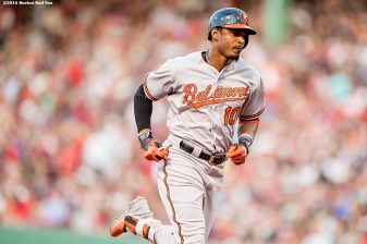 BOSTON, MA - JUNE 16: Adam Jones #10 of the Baltimore Orioles rounds the bases after hitting a two run home run during the third inning of a game against the Boston Red Sox on June 16, 2016 at Fenway Park in Boston, Massachusetts. (Photo by Billie Weiss/Boston Red Sox/Getty Images) *** Local Caption *** Adam Jones
