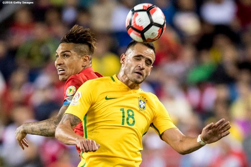 FOXBORO, MASSACHUSETTS - JUNE 12: Renato Augusto of Brazil heads a ball as he is defended by Paolo Guerrero of Peru during a group B match between Brazil and Peru at Gillette Stadium as part of Copa America Centenario US 2016 on June 12, 2016 in Foxboro, Massachusetts, US. (Photo by Billie Weiss/LatinContent/Getty Images)