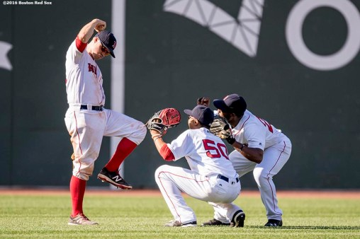 BOSTON, MA - JULY 3: Brock Holt #12, Jackie Bradley Jr. #25, and Mookie Betts #50 of the Boston Red Sox celebrate a victory against the Los Angeles Angels of Anaheim on July 3, 2016 at Fenway Park in Boston, Massachusetts. (Photo by Billie Weiss/Boston Red Sox/Getty Images) *** Local Caption *** Jackie Bradley Jr.; Brock Holt; Mookie Betts