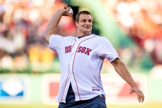 BOSTON, MA - JULY 19: New England Patriots tight end Rob Gronkowski throws out a ceremonial first pitch before a game between the Boston Red Sox and the San Francisco Giants on July 19, 2016 at Fenway Park in Boston, Massachusetts. (Photo by Billie Weiss/Boston Red Sox/Getty Images) *** Local Caption *** Rob Gronkowski