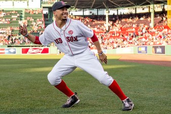 BOSTON, MA - JULY 21: Mookie Betts #50 of the Boston Red Sox reacts as he warms up before a game against the Minnesota Twins on July 21, 2016 at Fenway Park in Boston, Massachusetts. (Photo by Billie Weiss/Boston Red Sox/Getty Images) *** Local Caption *** Mookie Betts