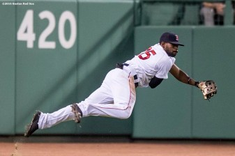 BOSTON, MA - AUGUST 9: Jackie Bradley Jr. #25 of the Boston Red Sox falls as he throws out Chase Headley #12 of the New York Yankees during the seventh inning of a game on August 9, 2016 at Fenway Park in Boston, Massachusetts. (Photo by Billie Weiss/Boston Red Sox/Getty Images) *** Local Caption *** Jackie Bradley Jr.