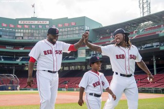 BOSTON, MA - AUGUST 11: David Ortiz #34 and Hanley Ramirez #13 of the Boston Red Sox, alongside his son Hansel, high five before posing for the team photograph before a game against the New York Yankees on August 11, 2016 at Fenway Park in Boston, Massachusetts. (Photo by Billie Weiss/Boston Red Sox/Getty Images) *** Local Caption *** David Ortiz; Hanley Ramirez; Hansel Ramirez