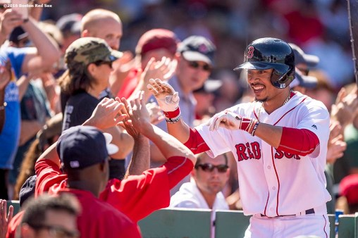 BOSTON, MA - AUGUST 14: Mookie Betts #50 of the Boston Red Sox reacts after hitting a home run during the fifth inning of a game against the Arizona Diamondbacks on August 14, 2016 at Fenway Park in Boston, Massachusetts. It was his third home run of the day. (Photo by Billie Weiss/Boston Red Sox/Getty Images) *** Local Caption *** Mookie Betts