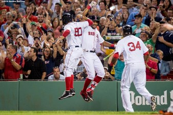 BOSTON, MA - SEPTEMBER 12: Mookie Betts #50 high fives Chris Young #30 alongside David Ortiz #34 of the Boston Red Sox after scoring during the first inning of a game against the Baltimore Orioles on September 12, 2016 at Fenway Park in Boston, Massachusetts. (Photo by Billie Weiss/Boston Red Sox/Getty Images) *** Local Caption *** David Ortiz; Mookie Betts; Chris Young