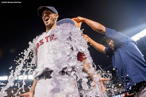 BALTIMORE, MD - SEPTEMBER 19: Rick Porcello #22 of the Boston Red Sox is given an ice bath after pitching a complete game against the Baltimore Orioles on September 19, 2016 at Oriole Park at Camden Yards in Baltimore, Maryland. (Photo by Billie Weiss/Boston Red Sox/Getty Images) *** Local Caption *** Rick Porcello