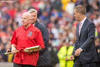 BOSTON, MA - OCTOBER 2: Boston Red Sox team doctor Dan Dyrek, President of Baseball Operations David Dombrowski, and President Sam Kenney present David Ortiz #34 of the Boston Red Sox with a golden bat during an honorary retirement ceremony in his final regular season game at Fenway Park against the Toronto Blue Jays on October 2, 2016 at Fenway Park in Boston, Massachusetts. (Photo by Billie Weiss/Boston Red Sox/Getty Images) *** Local Caption *** David Ortiz; David Dombrowski; Sam Kennedy; Dan Dyrek