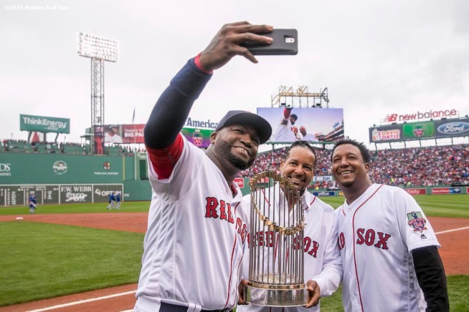 BOSTON, MA - OCTOBER 2: Former Boston Red Sox pitcher Pedro Martinez and former Boston Red Sox left fielder Manny Ramirez pose for a selfie photograph with the 2004 World Series with David Ortiz #34 of the Boston Red Sox during an honorary retirement ceremony in his final regular season game at Fenway Park against the Toronto Blue Jays on October 2, 2016 at Fenway Park in Boston, Massachusetts. (Photo by Billie Weiss/Boston Red Sox/Getty Images) *** Local Caption *** David Ortiz; Pedro Martinez; Manny Ramirez