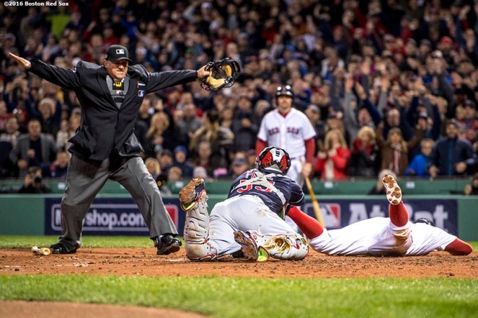 BOSTON, MA - OCTOBER 10: Xander Bogaerts #2 of the Boston Red Sox evades the tag of Roberto Perez #55 as he slides to score during the fifth inning of game three of the American League Division Series on October 10, 2016 at Fenway Park in Boston, Massachusetts. (Photo by Billie Weiss/Boston Red Sox/Getty Images) *** Local Caption *** Xander Bogaerts; Roberto Perez