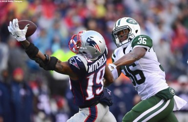 FOXBORO, MA - DECEMBER 24: Malcolm Mitchell #19 of the New England Patriots attempts to catch a pass as he is defended by Doug Middleton #36 of the New York Jets during the second quarter of a game at Gillette Stadium on December 24, 2016 in Foxboro, Massachusetts. (Photo by Billie Weiss/Getty Images) *** Local Caption *** Malcolm Mitchell; Doug Middleton