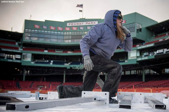 December 15, 2016, Boston, MA: A worker lays down boards as construction continues on the Frozen Fenway rink at Fenway Park in Boston, Massachusetts Thursday, December 15, 2016. (Photo by Billie Weiss/Boston Red Sox)