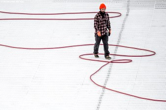 December 22, 2016, Boston, MA: A worker walks across a hose as the rink is installed in preparation for Frozen Fenway at Fenway Park in Boston, Massachusetts Thursday, December 22, 2016. (Photo by Billie Weiss/Boston Red Sox)