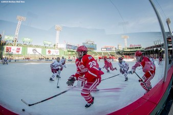BOSTON, MA - JANUARY 08: Jacob Forsbacka Karlsson #23 of Boston University handles the buck before scoring a goal during the first period of a Frozen Fenway game against the University of Massachusetts at Fenway Park on January 8, 2017 in Boston, Massachusetts. (Photo by Billie Weiss/Boston Red Sox/Getty Images) *** Local Caption *** Jacob Forsbacka Karlsson