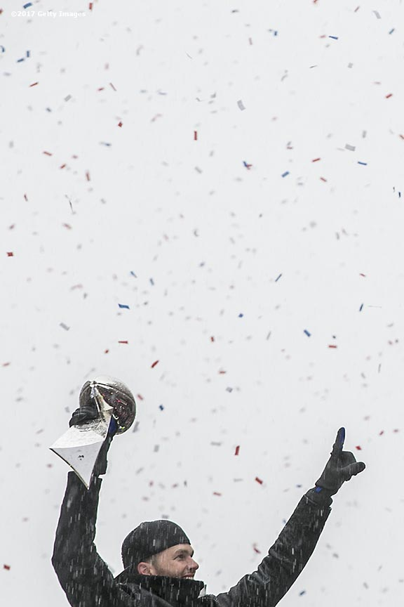 BOSTON, MA - FEBRUARY 07: Tom Brady of the New England Patriots holds the Vince Lombardi trophy during the Super Bowl victory parade on February 7, 2017 in Boston, Massachusetts. The Patriots defeated the Atlanta Falcons 34-28 in overtime in Super Bowl 51. (Photo by Billie Weiss/Getty Images) *** Local Caption *** Tom Brady