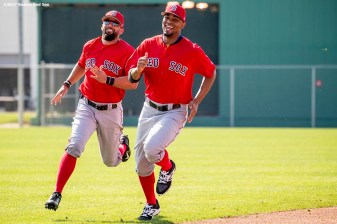 FT. MYERS, FL - FEBRUARY 18: Deven Marrero #17 and Xander Bogaerts #2 of the Boston Red Sox run sprints during a team workout on February 18, 2017 at Fenway South in Fort Myers, Florida . (Photo by Billie Weiss/Boston Red Sox/Getty Images) *** Local Caption *** Deven Marrero; Xander Bogaerts
