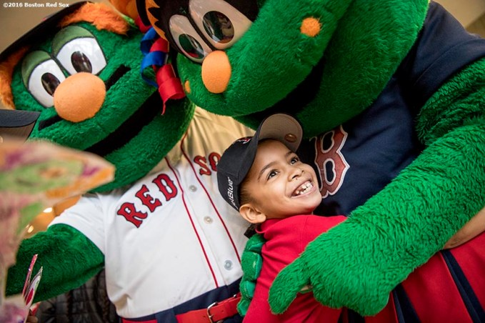 March 27, 2017, Boston, MA: A student reacts as she hugs Boston Red Sox mascots Wally the Green Monster and Tessie as Red Sox hats are given away during a visit to the Hennigan School in Jamaica Plain, Massachusetts Monday, March 27, 2017. (Photo by Billie Weiss/Boston Red Sox)
