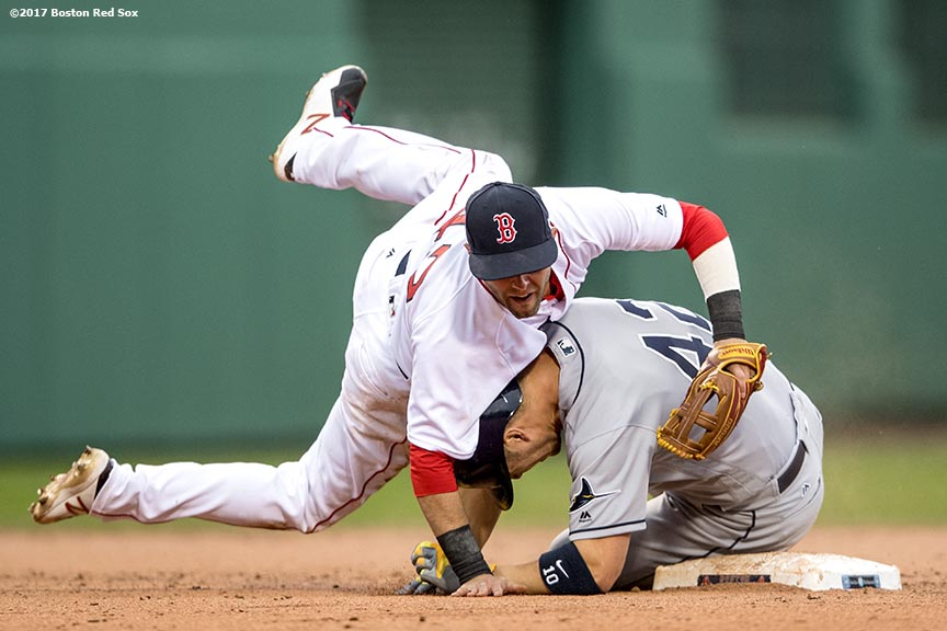 BOSTON, MA - APRIL 15: Dustin Pedroia #15 of the Boston Red Sox falls on Corey Dickerson #10 of the Tampa Bay Rays after turning a double play during the eighth inning of a game on April 15, 2017 at Fenway Park in Boston, Massachusetts. (Photo by Billie Weiss/Boston Red Sox/Getty Images) *** Local Caption *** Dustin Pedroia; Corey Dickerson
