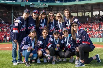 BOSTON, MA - APRIL 17: Members of the US Women's Ice Hockey Gold Medalist pose for a photograph before throwing out the ceremonial first pitch before a game between the Boston Red Sox and the Tampa Bay Rays on April 17, 2017 at Fenway Park in Boston, Massachusetts. (Photo by Billie Weiss/Boston Red Sox/Getty Images) *** Local Caption ***