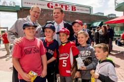 April 19, 2017, Boston, MA: Boston Red Sox president Sam Kennedy and Boston Mayor Marty Walsh pose for a photograph with kids during Little League Opening Day at Fenway Park in Boston, Massachusetts Wednesday, April 19, 2017. (Photo by Billie Weiss/Boston Red Sox)
