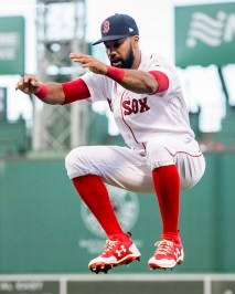 BOSTON, MA - MAY 3: Chris Young #30 of the Boston Red Sox leaps as he warms up before a game against the Baltimore Orioles on May 3, 2017 at Fenway Park in Boston, Massachusetts. (Photo by Billie Weiss/Boston Red Sox/Getty Images) *** Local Caption *** Chris Young