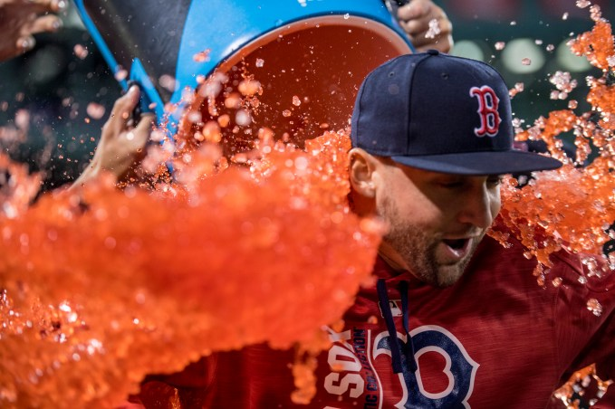 BOSTON, MA - MAY 24: Sam Travis #59 of the Boston Red Sox is doused with Powerade after a game against the Texas Rangers on May 24, 2017 at Fenway Park in Boston, Massachusetts. It was his Major League debut. (Photo by Billie Weiss/Boston Red Sox/Getty Images) *** Local Caption *** Sam Travis