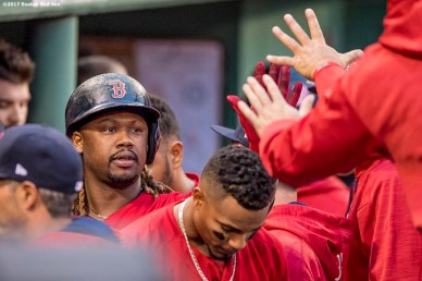 BOSTON, MA - MAY 26: Hanley Ramirez #13 of the Boston Red Sox high fives teammates after scoring during the second inning of a game against the Seattle Mariners on May 26, 2017 at Fenway Park in Boston, Massachusetts. (Photo by Billie Weiss/Boston Red Sox/Getty Images) *** Local Caption *** Hanley Ramirez