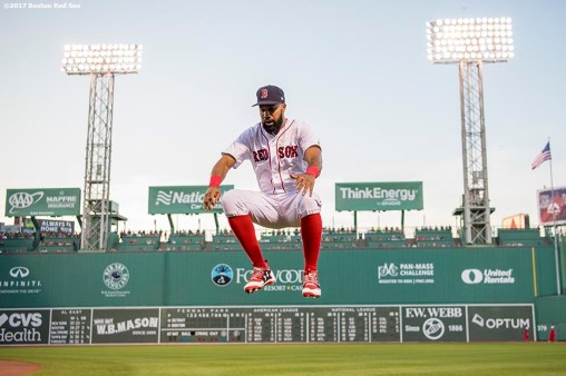 BOSTON, MA - JUNE 11: Chris Young #30 of the Boston Red Sox jumps as he warms up before a game against the Detroit Tigers on June 11, 2017 at Fenway Park in Boston, Massachusetts. (Photo by Billie Weiss/Boston Red Sox/Getty Images) *** Local Caption *** Chris Young