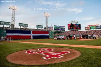 BOSTON, MA - JUNE 23: The flag of the Dominican Republic is dropped over the Green Monster during a ceremony for the retirement of the jersey number of David Ortiz before a game against the Los Angeles Angels of Anaheim on June 23, 2017 at Fenway Park in Boston, Massachusetts. (Photo by Billie Weiss/Boston Red Sox/Getty Images) *** Local Caption *** David Ortiz
