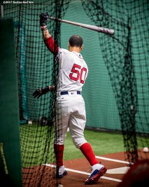 BOSTON, MA - JUNE 29: Mookie Betts #50 of the Boston Red Sox takes swings in the batting cage before a game against the Minnesota Twins on June 29, 2017 at Fenway Park in Boston, Massachusetts. (Photo by Billie Weiss/Boston Red Sox/Getty Images) *** Local Caption *** Mookie Betts