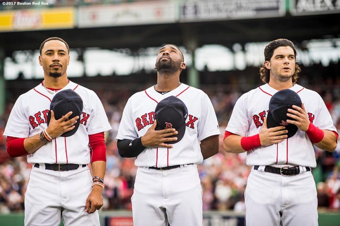 BOSTON, MA - JUNE 29: Mookie Betts #50, Jackie Bradley Jr. #19, and Andrew Benintendi #16 of the Boston Red Sox stand during the National Anthem before a game against the Minnesota Twins on June 29, 2017 at Fenway Park in Boston, Massachusetts. (Photo by Billie Weiss/Boston Red Sox/Getty Images) *** Local Caption *** Mookie Betts; Andrew Benintendi; Jackie Bradley Jr.