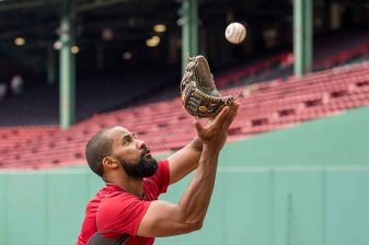 BOSTON, MA - JULY 15: Chris Young #30 of the Boston Red Sox fields a ball off of the green monster wall before a game against the New York Yankees on July 15, 2017 at Fenway Park in Boston, Massachusetts. (Photo by Billie Weiss/Boston Red Sox/Getty Images) *** Local Caption *** Chris Young