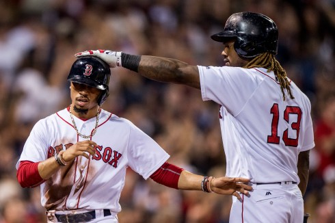 BOSTON, MA - JULY 16: Mookie Betts #50 high fives Hanley Ramirez #13 of the Boston Red Sox after scoring during the sixth inning of a game against the New York Yankees on July 16, 2017 at Fenway Park in Boston, Massachusetts. (Photo by Billie Weiss/Boston Red Sox/Getty Images) *** Local Caption *** Mookie Betts; Hanley Ramirez