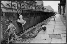 Henri Cartier-Bresson / Magnum Photos. The girl extends herself near the Phi line, while the wall forms a strong diagonal vanishing point.