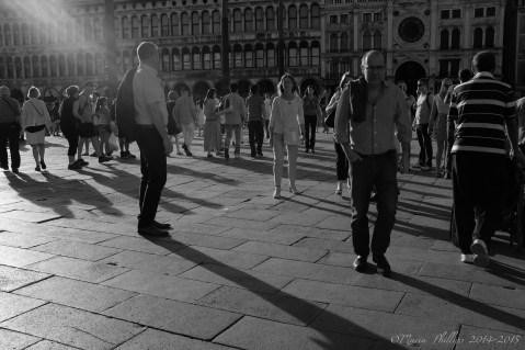 High resolution image taken with a high end digital camera. Incredibly fast shutter speeds allow for movement to appear frozen, despite the different speeds that each person was moving at. This is a piece of straight documentary street photography that due to the lighting and the lack of apparent movement in the shot adds to its artfulness, and the impression possibly that it has been staged.
