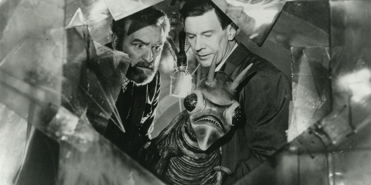 We've got a screen shot of a giant damn grasshopper and two scientists that are confused as hell in Quatermass and the Pit.